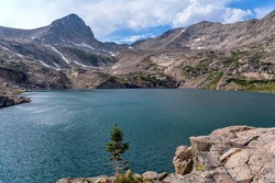 Summer Blue Lake - A stormy Summer afternoon view of Blue Lake (11,355'), a pristine alpine lake at base of summit of Mount Toll in Indian Peaks Wilderness, Colorado, USA.
