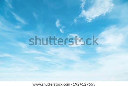 Summer Blue Sky and white cloud white background. Beautiful clear cloudy in sunlight calm season. Panoramic vivid cyan cloudscape in nature environment. Outdoor horizon skyline with spring sunshine.