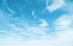 Summer Blue Sky and white cloud white background. Beautiful clear cloudy in sunlight spring season. Panoramic vivid cyan cloudscape in nature environment. Outdoor horizon skyline with spring sunshine.