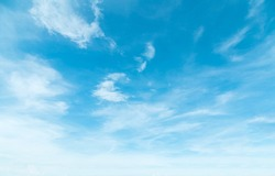 Summer Blue Sky and white clouds background. Beautiful clear cloudy in sunlight spring season. Panoramic vivid cyan cloudscape in nature environment. Outdoor horizon skyline with spring sunshine.