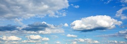 Summer blue sky background wiht white clouds .