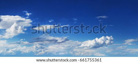 Summer blue sky with fluffy clouds - Shutterstock ID 661755361