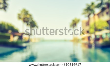Summer blur background resort hotel swimming pool party relaxation with blue cool sky and tropical palm tree