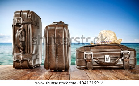 Summer brown travel suitcase and ocean landcape. Free space for your decoration.  - Shutterstock ID 1041315916