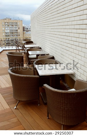 Summer cafe on a house roof. Cityscape. - stock photo
