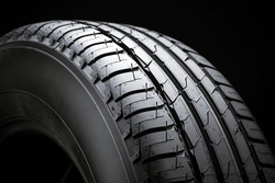 summer car tire tread, side view, black background