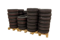 Summer car tires fold up for sale in a store. Retail sale of car tires. Tires isolated on a white background.