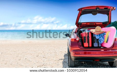 summer car with suitcase and...