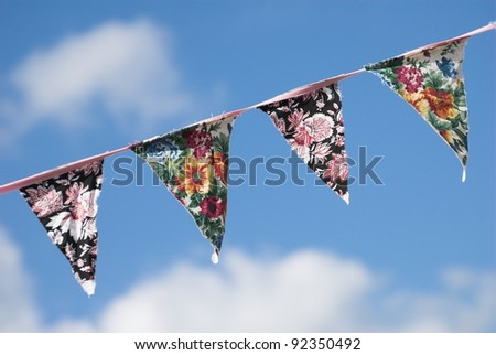 Summer chintz bunting isolated against a blue sky