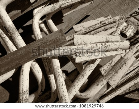 Summer, city, building site, demolition of the house. In the frame there are many old small pieces of pipes. Black and white image. Horizontal frame #1081929746