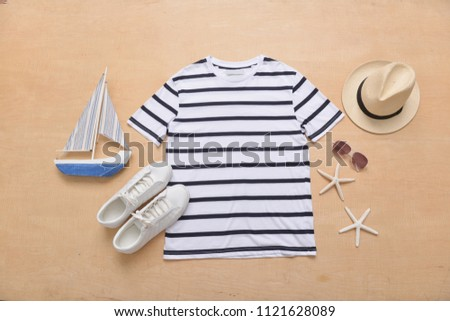 summer clothes collage on white,sunglasses,starfish, , hat, wooden boat , shoes , flat lay, top view