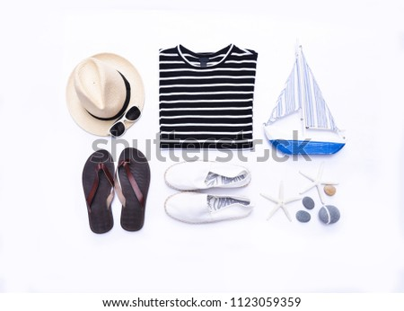 summer clothes collage on white -sunglasses,starfish, , hat, wooden boat ,shoes ,stones on flat lay, top view