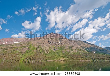 Summer clouds over Rising Wold Mountain in Glacier National park