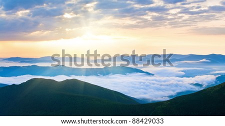 Summer cloudy sunrise mountain panorama view (Ukraine, Carpathian Mountains). Two shots stitch image.