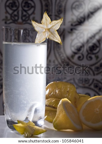 Summer cocktail with lemon and carambola.