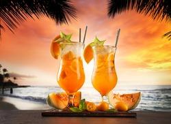 Summer cocktails with blur beach on background