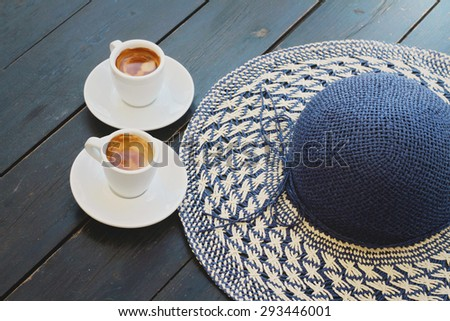 Summer coffee break , female straw  hat and two cups of espresso