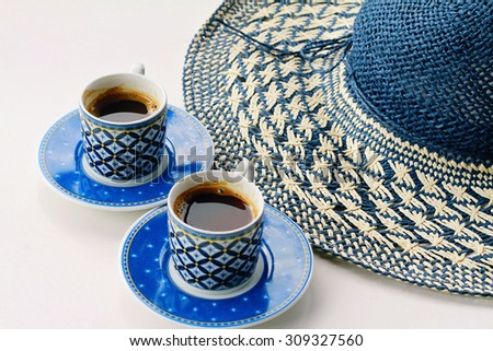 Summer coffee break , female straw hat and two cups of turkish coffee