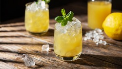 Summer cold cocktail with strong sun lights, selective focus image and slider format