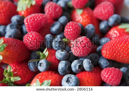 Summer collection of berries - strawberries, blueberries & raspberries, shallow depth of field. Great background image