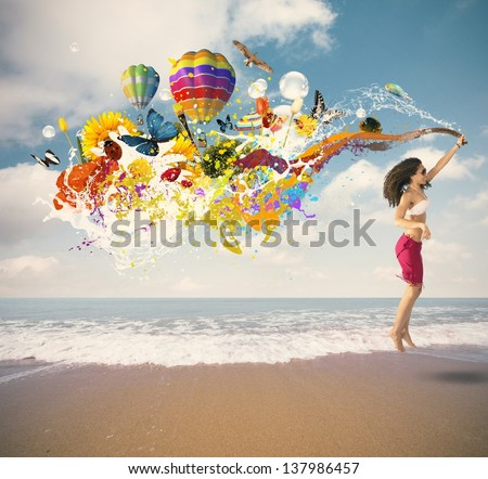 Summer color explosion with jumping girl at the beach - stock photo