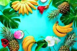 Summer colorfull concept with tropical fruits and flowers, flat lay, space for a text