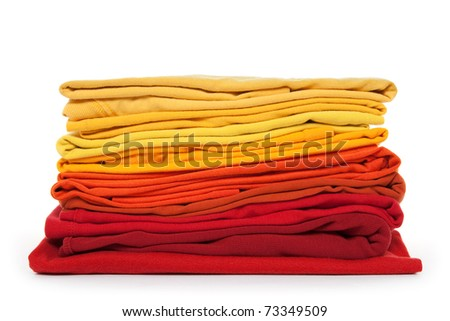 Summer colors. Red and yellow folded clothes on white background.