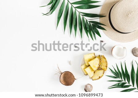 Summer composition. Tropical palm leaves, hat, pineapple, coconut on white background. Summer concept. Flat lay, top view, copy space #1096899473