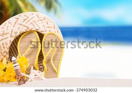 Stock Photo Summer concept, flip-flops, summer accessories on summer beach