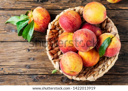Summer concept. Fresh sweet peaches on the wooden table, selective focus #1422013919