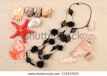 Summer concept - sand stones and seashells frame