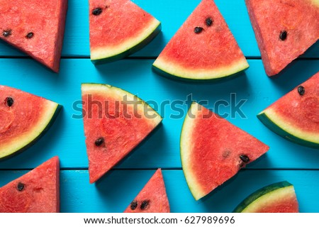 Summer concept : Sliced watermelon on blue rustic wood background. - Shutterstock ID 627989696