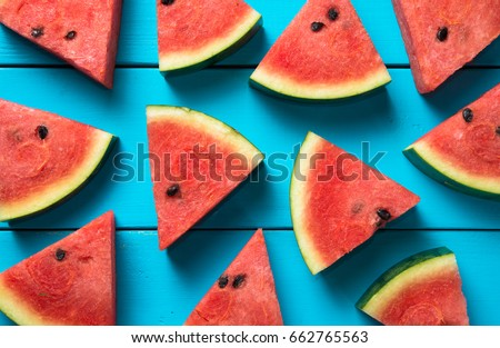 Summer concept : Sliced watermelon on blue rustic wood background. - Shutterstock ID 662765563