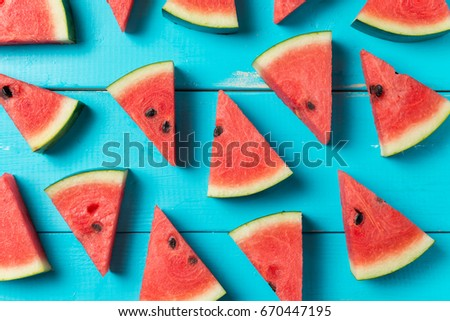 Summer concept : Sliced watermelon on blue rustic wood background. - Shutterstock ID 670447195