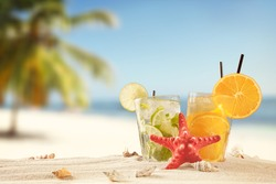 Summer concept with exotic drinks, starfish and accessories.
