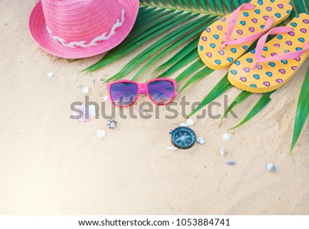 Summer concept with hat,sunglasses,sandals and compass on sand beach. #1053884741