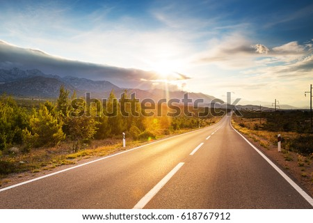 Summer country road with trees beside. Rural up hill, vintage , environment road.Nature road.Asphalt road.