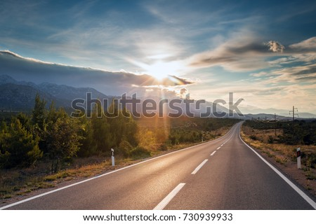 Stock Photo Summer country road with trees besides. Rural uphill, vintage, environment road.Nature road.Asphalt road.