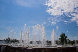 Summer day. Volga embankment is the pearl of Yaroslavl. Park on Arrow. Fountain jets in the sun