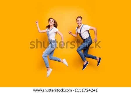 Summer dreamy student freedom fly teen age youth person concept. Side view full size length photo portrait of two cheerful rejoicing attractive handsome guy lady making movement isolated background