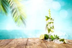 Summer drink on desk and beach landscape