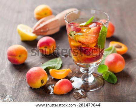 Summer drink with apricot ( or peach)  in glass, selective focus