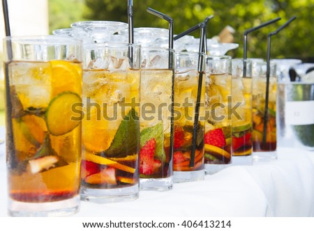 Summer drinks lined up on a table with straws #406413214
