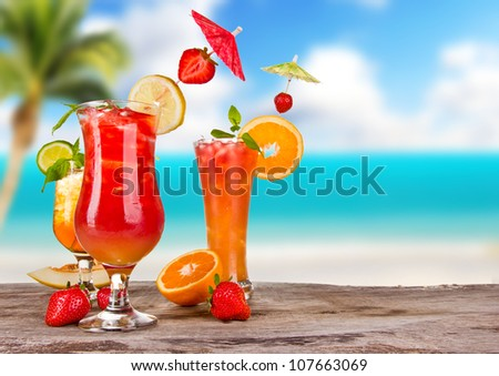 Summer drinks with blur beach on background