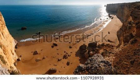 Summer evening Atlantic rocky coast view with sandy beach Praia da Afurada (Lagoa, Algarve, Portugal). Two shots stitch panorama.