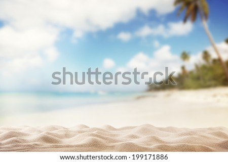Stock Photo Summer exotic sandy beach with blur palms and sea on background