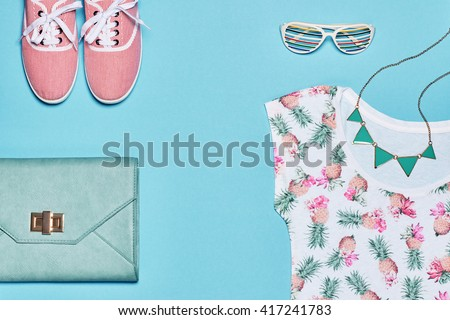 Summer fashion girl clothes accessories set. Creative hipster outfit, pastel colors. Stylish gumshoes, trendy summer dress, handbag, sunglasses. Unusual overhead, summer top view outfit