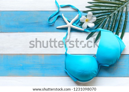 Summer Fashion woman blue swimsuit Bikini,  starfish and spa flower.  Travel and vacations in the holiday, wood white and blue  background., top view. Summer Concept.