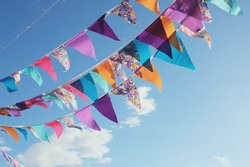 Summer festive bright colorful vintage bunting decoration and blue sky, happy joy freedom celebration , social distancing concept