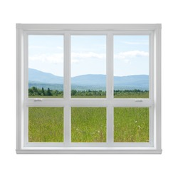 Summer field and mountains seen through the window.